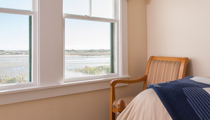 View of tidal river from cottage bedroom