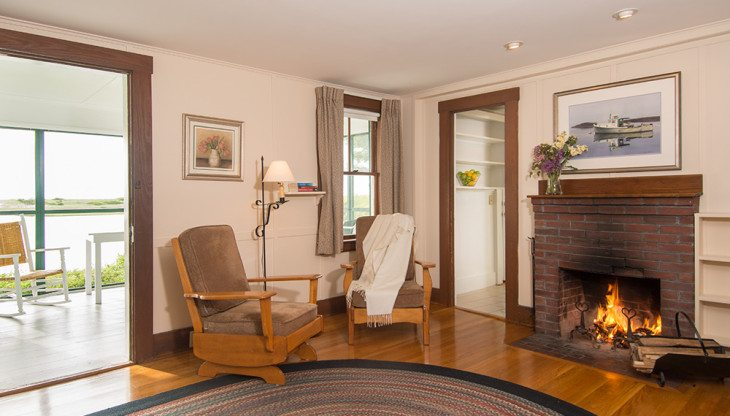 fireplace nook in living room with two lounge chairs